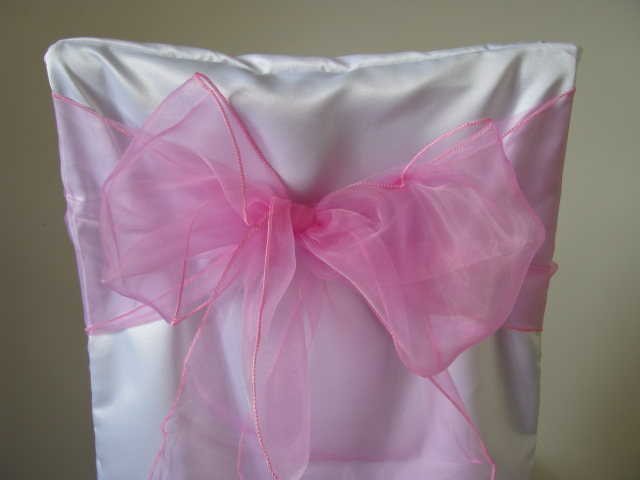 white chair covers and bubblegum pink