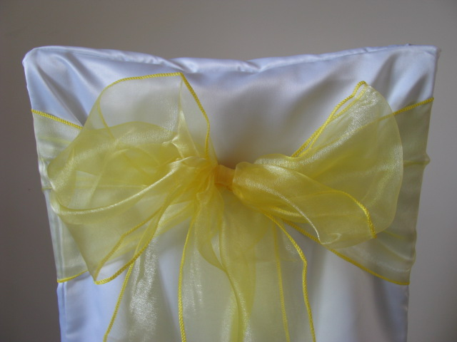 white chair covers and lemon sashes