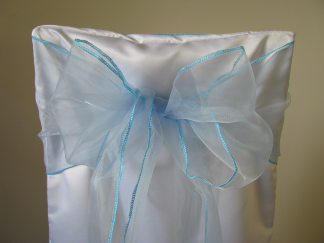 white chair covers and light blue sashes