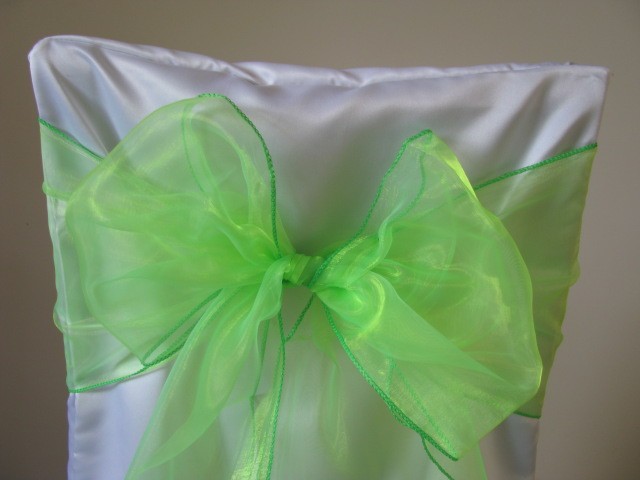 white chair covers and lime green sashes