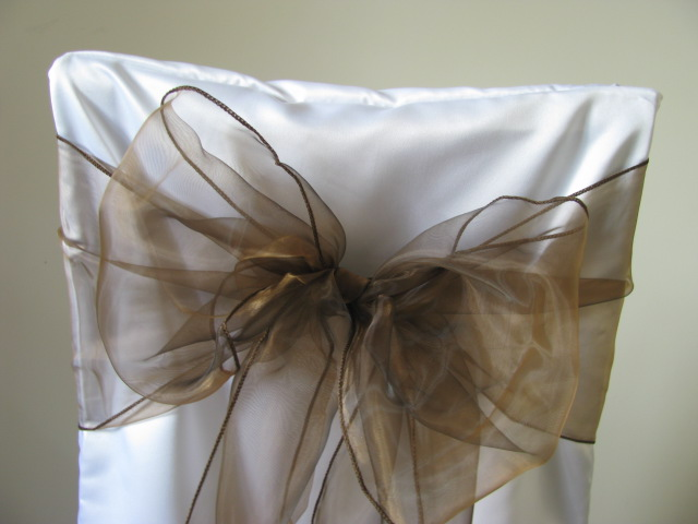 white chair covers and mocha sashes