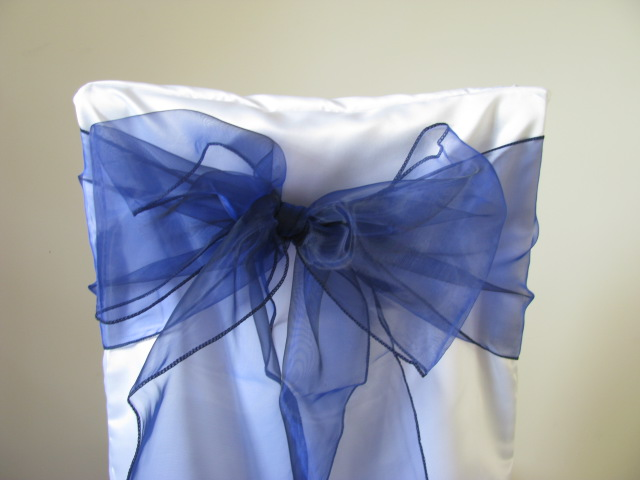 white chair covers and navy sashes