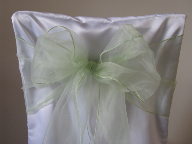 white chair covers and sage sashes