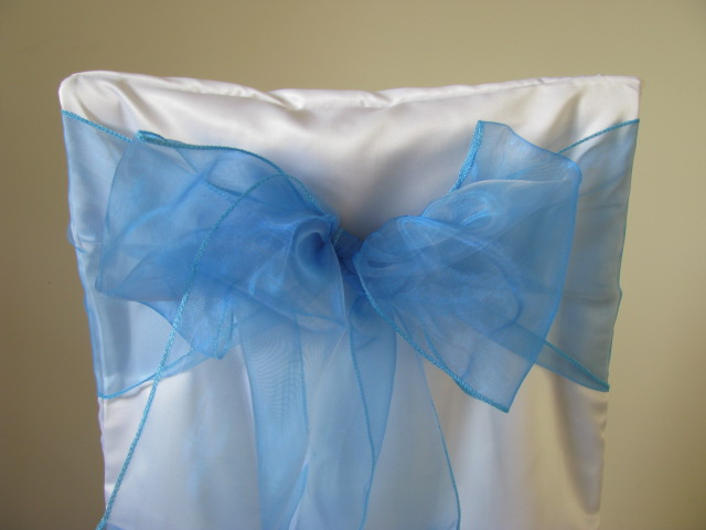 white chair covers and turquoise sashes